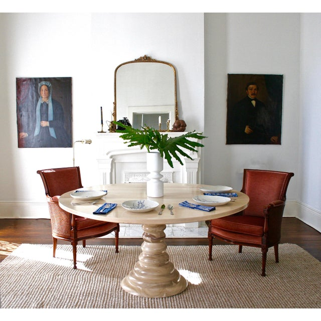The Amelia round wooden dining table is crafted from carved poplar and wooden maple planks. Made from carved wood,...