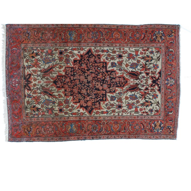 A wool pile, hand made, antique, Persian Malayer rug.
