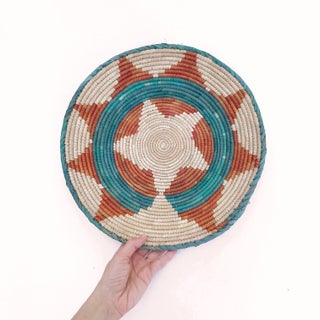 1970's African Flat Weave Coil Basket With Orange and Teal Star and Sun Pattern Preview