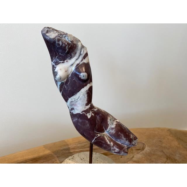 Beautiful 1960's sculpture of a nude figure, made of purple and white veined marble on a travertine base. Signed by artist...