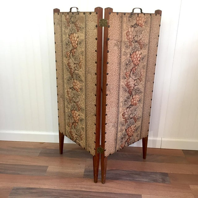 Antique sewing stand from the early 1900s. Built to stand beside a chair, the hinged panels open to for use and fold away...