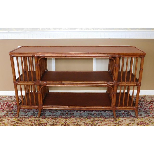 Great Ethan Allen rattan media console or sofa table circa 2004. Nicely colored rattan frame. Narrow rectangular form with...