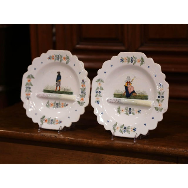 Decorate a shelf with this pair of antique decorative plates from Brittany, France. Crafted circa 1883-1895, each faience...