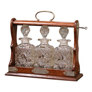 Early 20th Century English Oak and Brass Tantalus With Cut-Glass Decanters - 4 Pieces For Sale