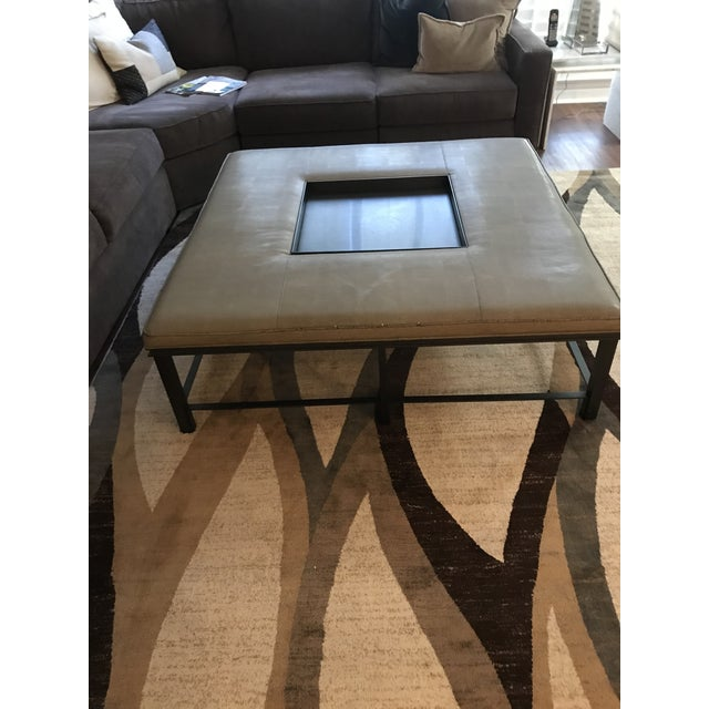 Fabulous Baker coffee table of fabric and steel. The center is a steel tray that is removable and the outside perimeter of...