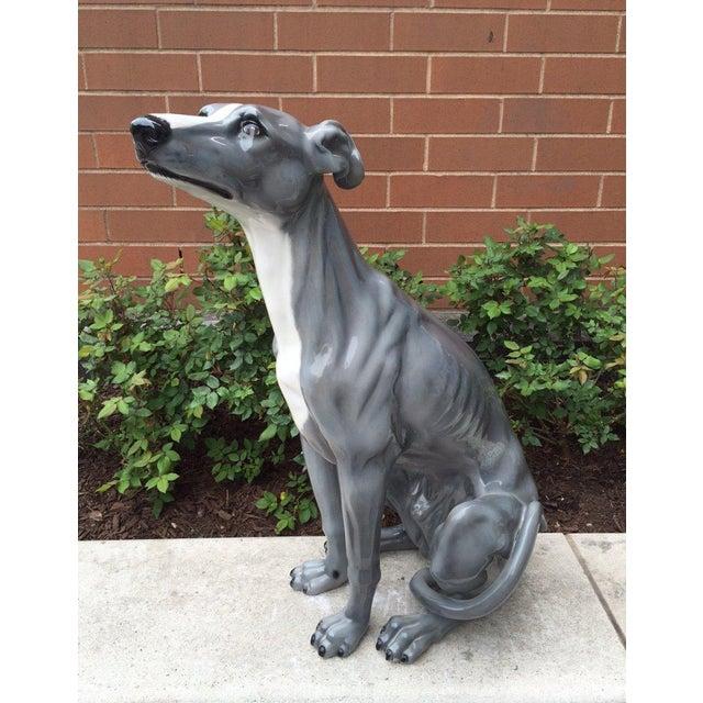 Glazed ceramic sculpture of a dog.