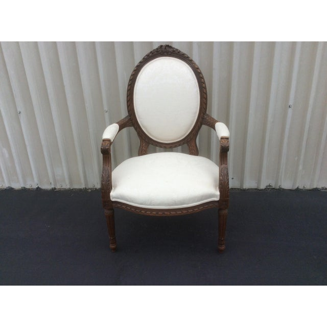 Nice scale French style arm chair with ivory colored fabric. Note that there is another French arm chair with oval back...