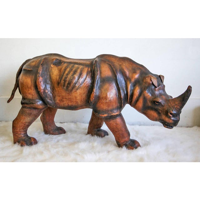 A monumental leather rhinoceros. The sculpture is incredibly beautiful, made from a wooden frame and clad completely in...