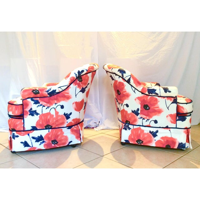 A pair of SUPER cute barrel swivel club chairs, fleshly reupholster in a Kate Spade design, floral printed chintz fabric,...