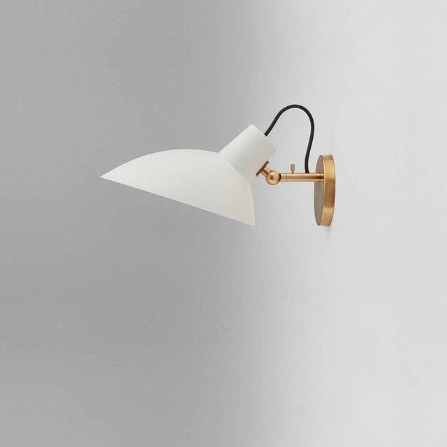 **NOTE: 6-8 WEEK LEAD TIME** Pair of Vittoriano Viganò 'VV Cinquanta' sconces in white and brass for Astep. Viganò was the...