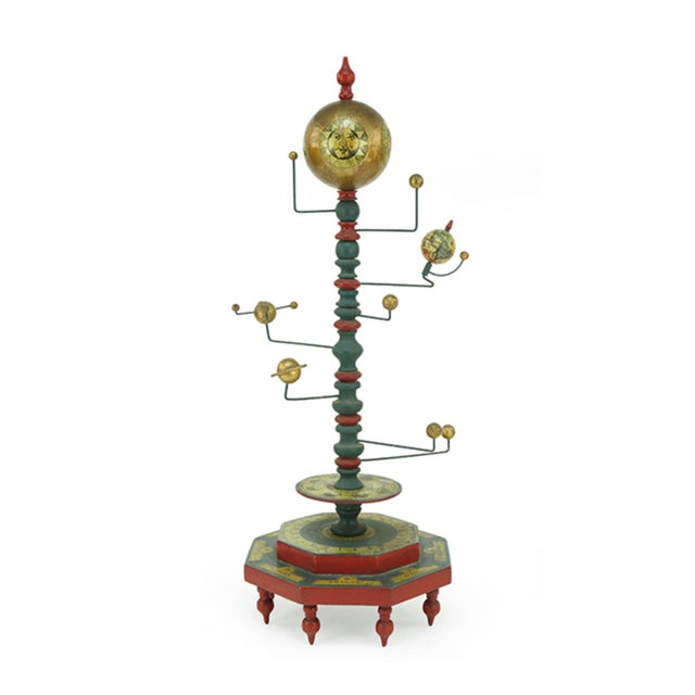 This is an Orrery from the mid 20th Century. This piece depicts a painted wood and metal revolving model of the sun and...