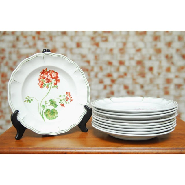 """Set of 66 French dinner plates with hand-painted floral specimens. All stamped with the """"luneville"""" brand and artist..."""