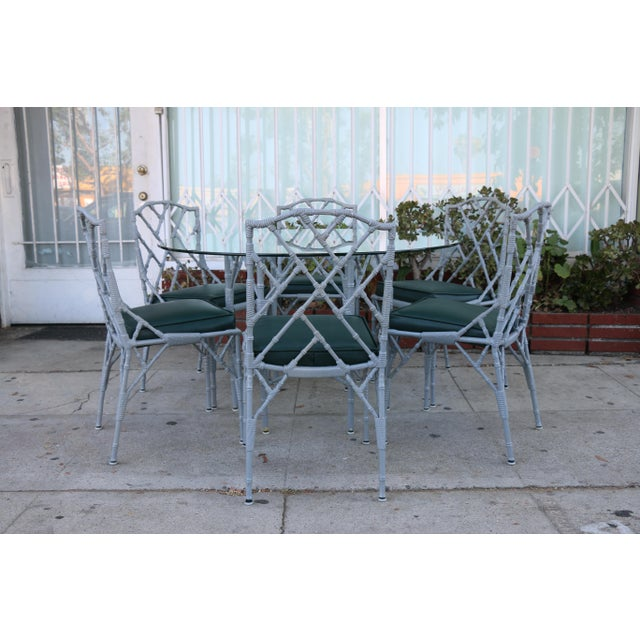 Vintage cast iron patio set in well kept condition. Seats have been reupholstered. Glass top table is well kept. Cast iron...