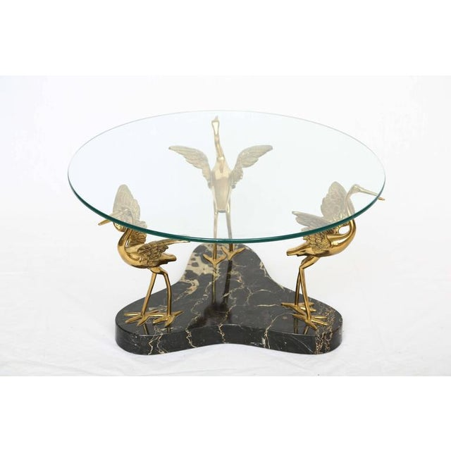 We offer a one of a kind marble and brass birds coffee table influenced by Willy Daro. The birds are made with great...