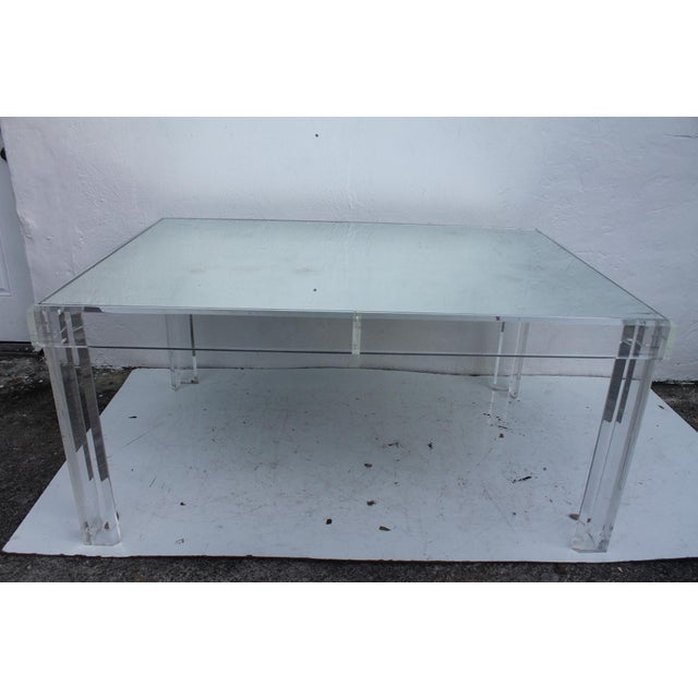 Offered is a mid-century modern rectangular Lucite dining table with insert mirrored glass top. Signed and date (VJJ...