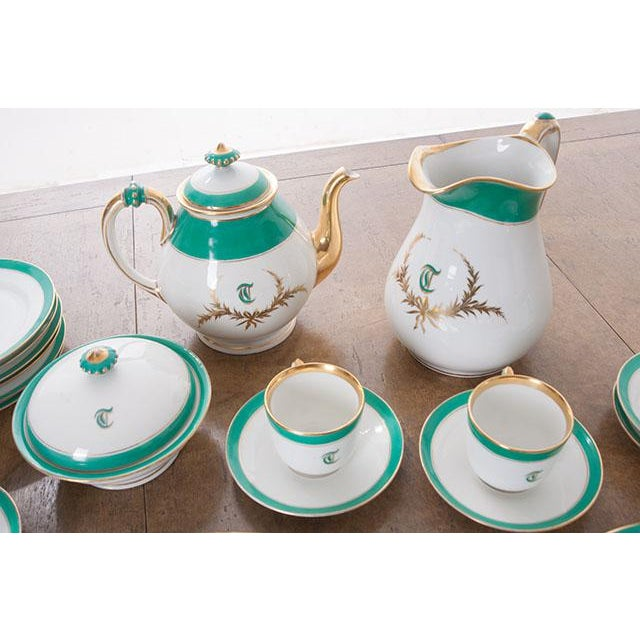 A stunning 33-piece set of Old Pairs white porcelain hand-painted and gold gilt dessert service. The letter 'T' adorns...