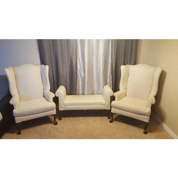 Pair of Antique Mahogany Ball & Claw Wing Back Arm Chairs with Ottoman