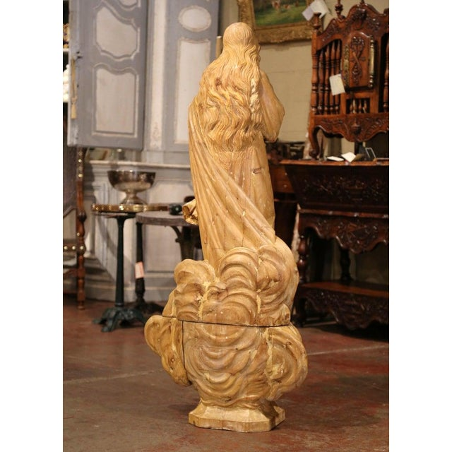 This large antique female statue in two sections, was crafted in Normandy, France circa 1820. Made of pine wood, the tall...