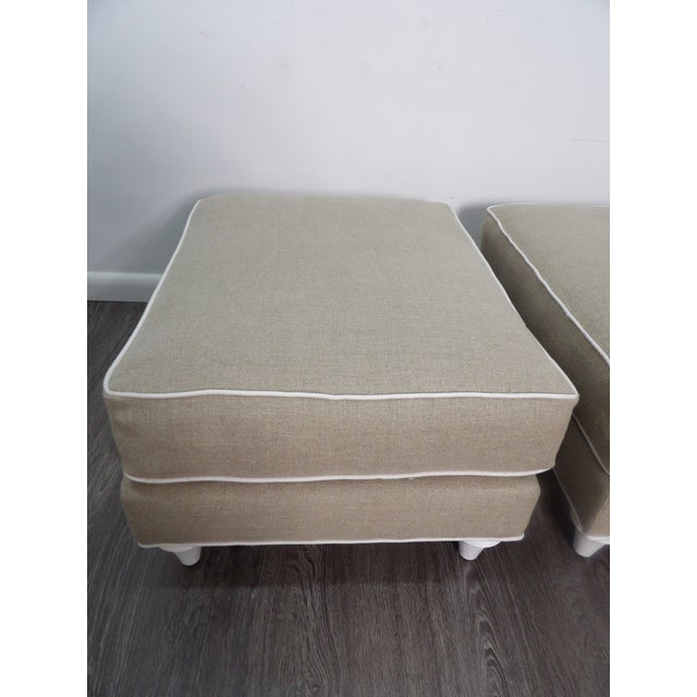 Pair of Baker Furniture Company Ottomans in New Upholstery. The Color of the new dense cotton fabric is light khaki / tan...