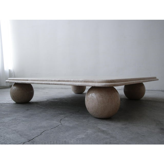 Great post modern designed travertine coffee table. Table is very low profile. Square top rest on 4 large ball feet. Table...
