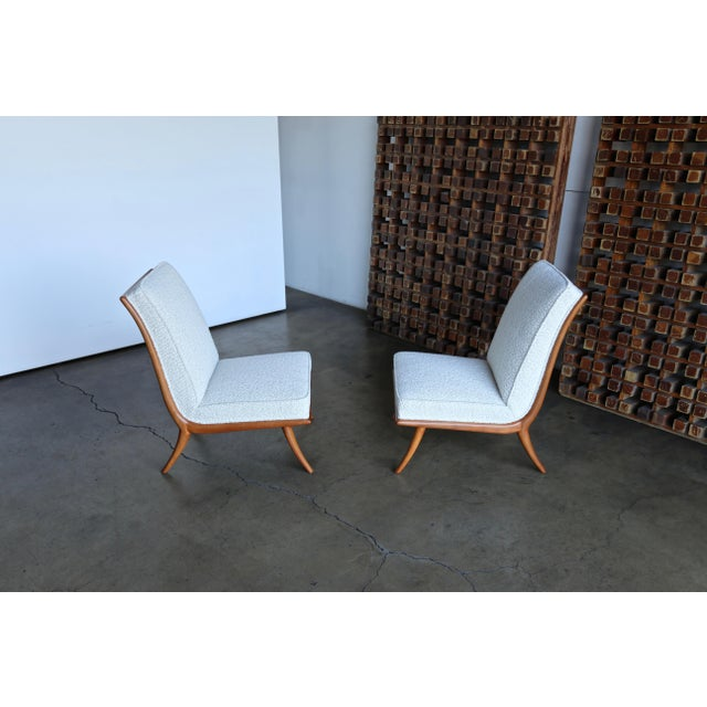 T.H. Robsjohn-Gibbings slipper chairs for Widdicomb, circa 1955. This pair has been professionally restored.