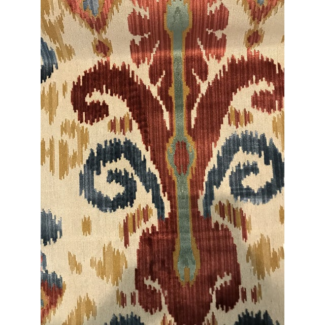 """An amazing velvet ikat in rich, saturated color. Woven in Belgium of 80% viscose, 20% cotton. Bolts are 53.5"""" wide with a..."""