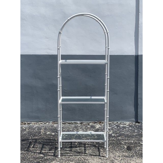 Bright white, faux bamboo etagere with glass shelves. Ample space to store books, sculptures or whatever you collect....