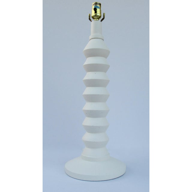 Vintage: Mid-Century, solid and heavy, plaster, zig-zag tiered table lamp, with a finial ball top and original felted base...