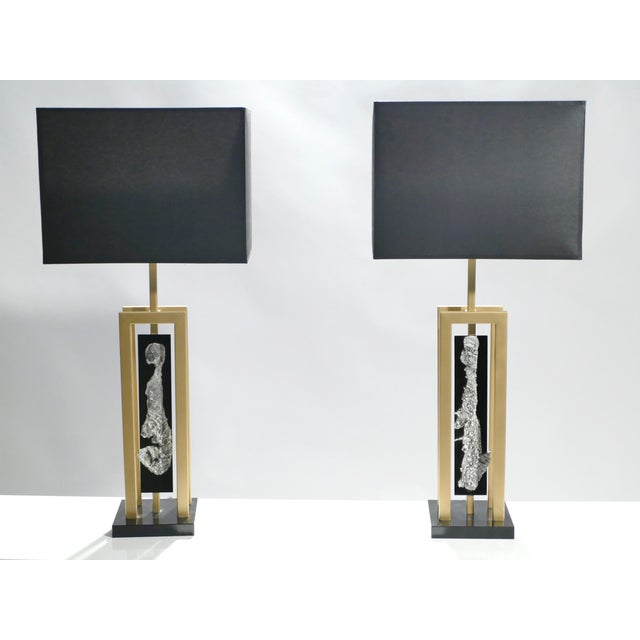 This pair of table lamps possesses the unique allure that is held by unconventional, decorative designs, most notably...