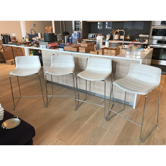 Arper Catifa collection. Set of 4 super comfortable low back counter height stools. Sled base in chromed steel with rod...