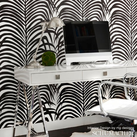 A striking hybrid that recalls both zebra stripes and tropical palm leaves, by Schumacher. This is a double roll of...