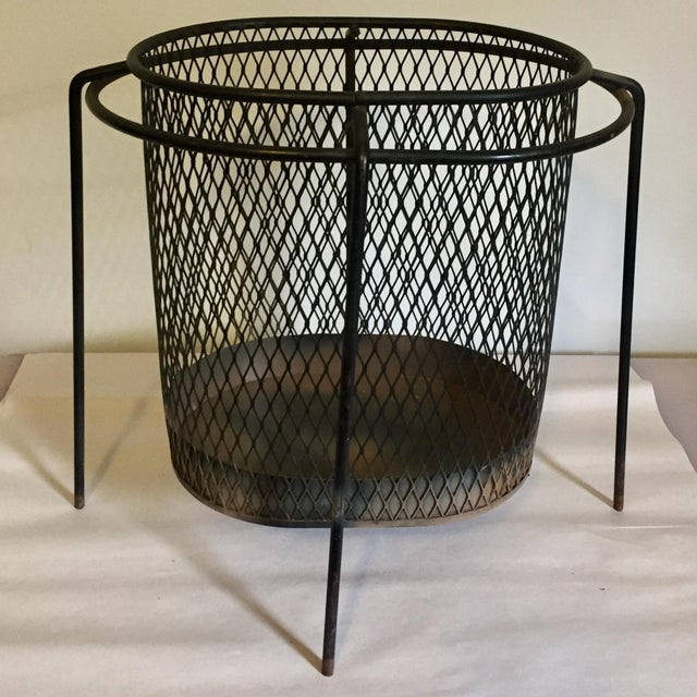 1950s iron mesh wastebasket designed by Maurice Duchin. Minor wear and rusting appropriate with age and detailed in pictures.