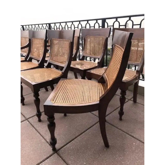 Set of eight rosewood Anglo-Indian Regency style dining chairs. Caned seats and back. Caned backs and seat. Measures: 2...