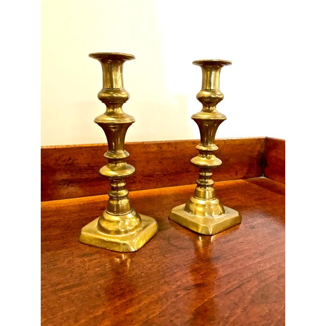 This is the second of two pairs of English Victorian brass Push-Up candlesticks. These sticks are in overall very good...