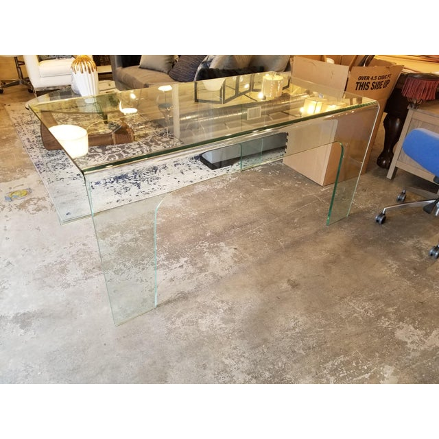 This is a really cool desk made of one 1/2-inch thick piece of glass. it's in great condition, and very heavy.