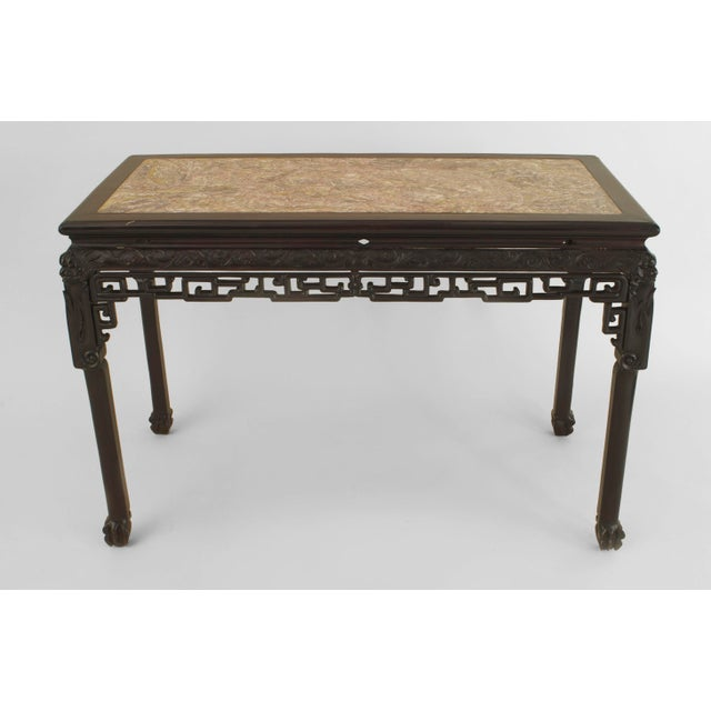 Asian Chinese style (18/19th Cent) rosewood rectangular center table with a carved apron having a filigree bottom edge...
