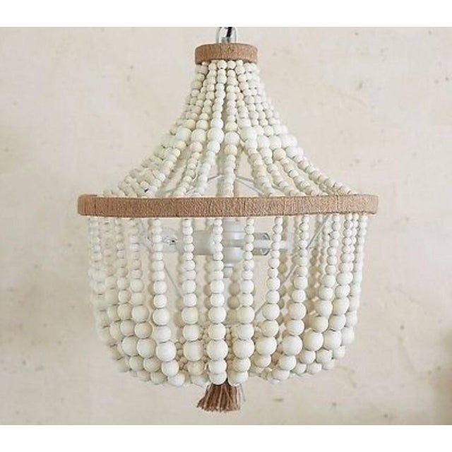 Brand New in box. Currently available at PB Kids for $249. Wood beads in soft, natural hues bring warmth and simplicity to...