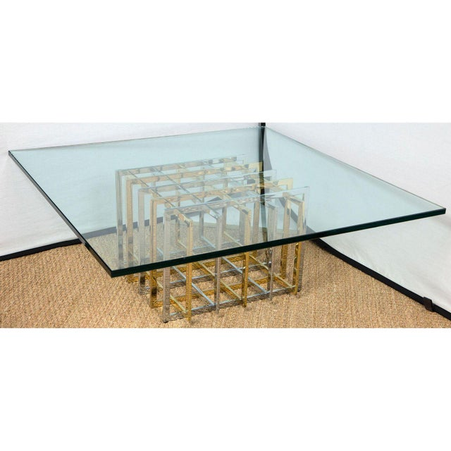 Classic 1970 Pierre Cardin sculptural grid/puzzle table with intersecting two-tone metal. The base is in pristine...