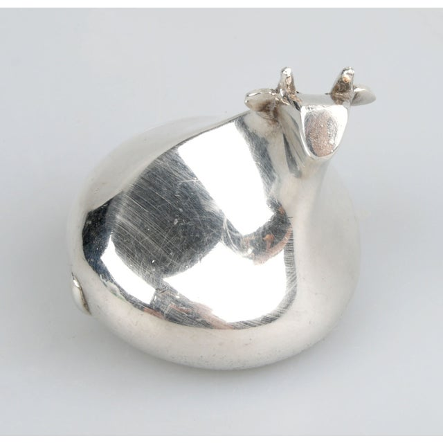 Signed Dansk International Design silver-plated cow paperweight. Marked on underside.