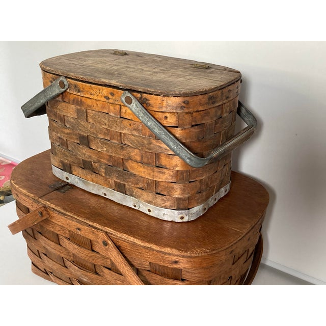 """A set of 2 early 20th century woven baskets, decorative and useful for picnics. The stack measures 18"""" high, 12"""" deep 16""""wide"""