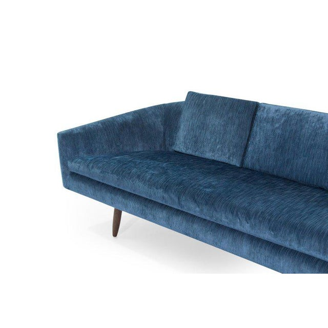 An impressive and very comfortable low profile sofa designed by Adrian Pearsall for Craft Associates, circa 1950s. Walnut...
