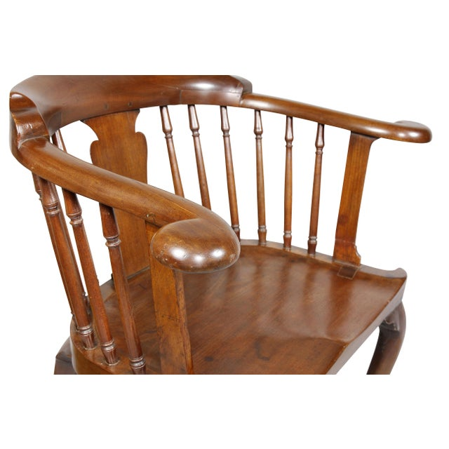 U-shaped back with baluster form splat flanked by spindles and out scrolled hand holds, saddle seat raised on cabriole...