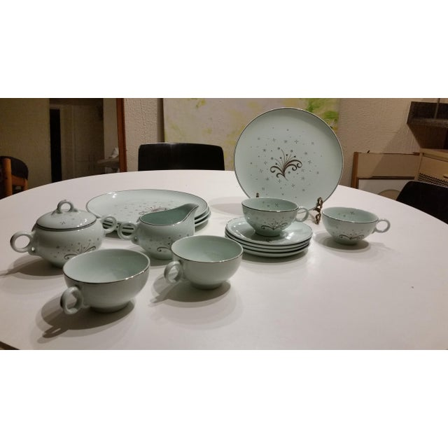 This is a beautiful, whimsically designed 1950s set of china from Universal Potteries' Ballerina Mist line. Light jade in...