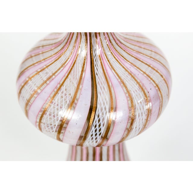 """A sensuous, baluster shape, Venetian glass lamp; with pink and """"goldstone"""" (copper aventurine glass), vertical Latticino..."""