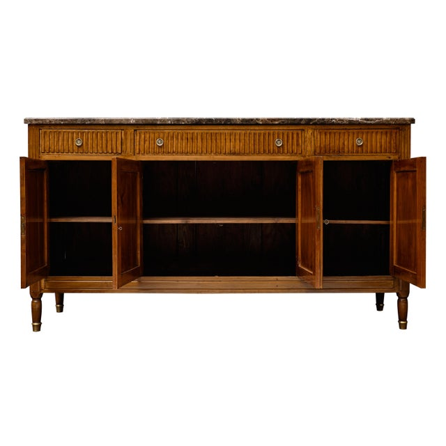 French antique Louis XVI style walnut buffet. This piece is made of figured blonde walnut wood from the Rhone Valley with...