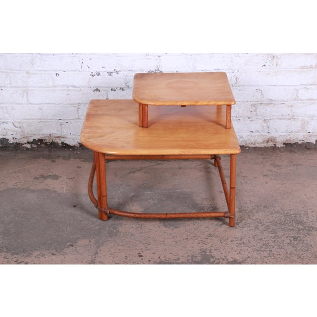 A nice and unique mid-century modern Hollywood Regency style end table from the Ashcraft line by Heywood Wakefield. The...
