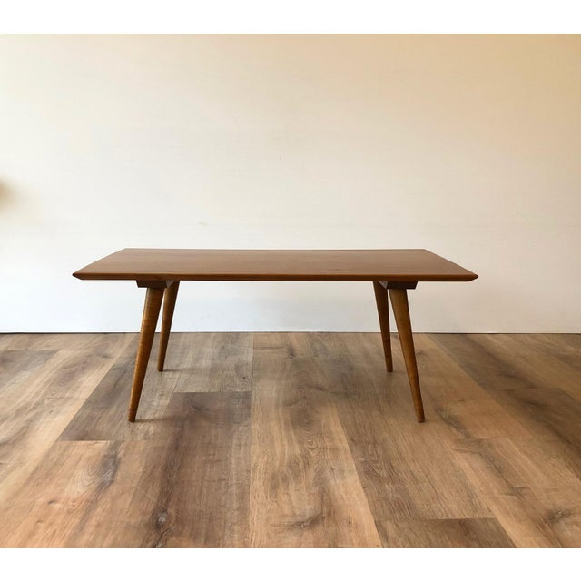 Shorter in length than the Paul McCobb's standard coffee table. Sleek and with a low profile. Sturdy and in good vintage...