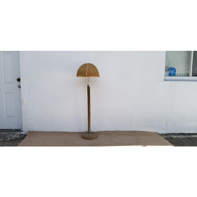 This is a vintage Paul Frankl style rattan and chrome floor lamp. The piece is from the 1970s. Dimensions : Form the...