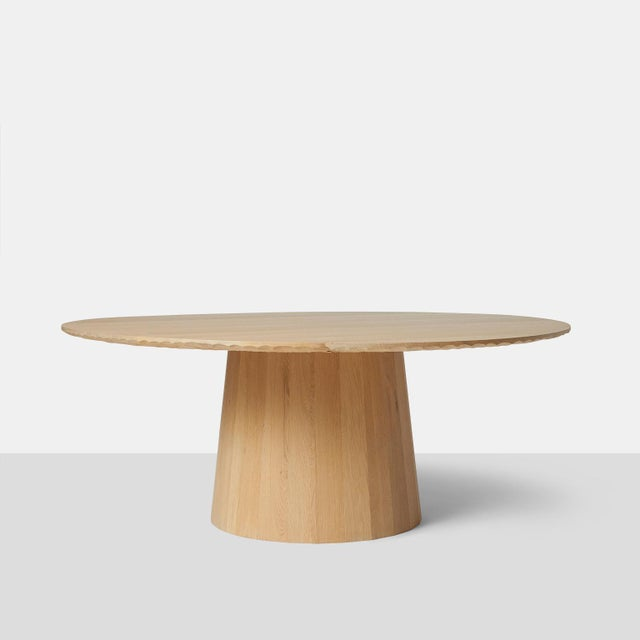 Oak dining table by Kaspar Hamacher A large round dining table in oak completely handmade with hand scraped detail on edge...