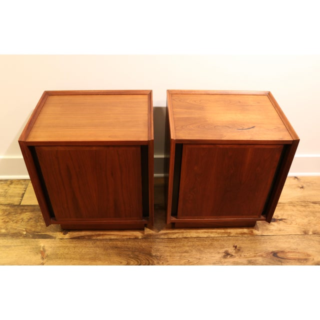 Simple and beautiful walnut nightstand by Dillingham. There's a lot of interior storage including a slide out white...